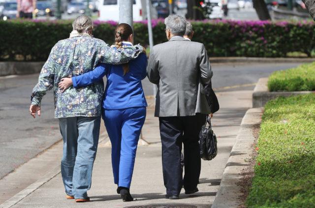 Retired HPD Chief Louis Kealoha Katherine Kealoha embrace while walking towards ewa on Halekauwila street after US District court.