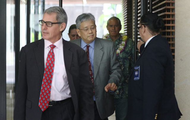 Attorneys lead the way out of US District Court with Retired HPD Chief Louis Kealoha and wife Katherine Kealoha. Myles Breiner at left.