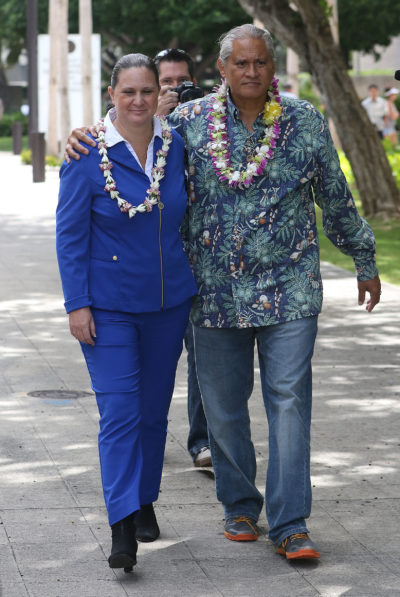 Retired HPD Chief Louis Kealoha wife Katherine Kealoha leave district court in embrace and walking.