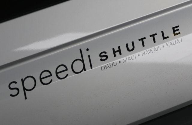 Speedi Shuttle Dan Inouye International Airport parked.