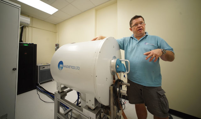 MR Solutions Installation and Commissioning Technician, Ross Anderson from MR Solutions, a British company works in installing and setting up a brand spanking new MRI at UH Manoa Biomed building.