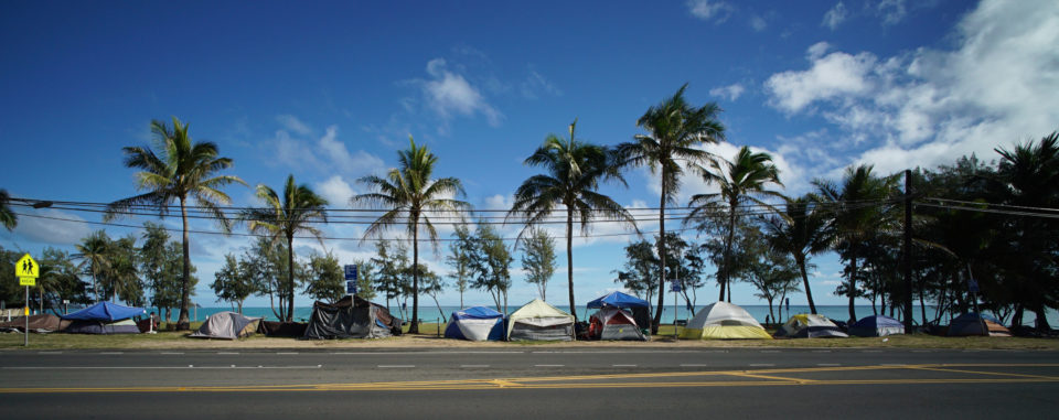 Tents in a row near Waimanalo Beach Park along Kalanianiole Highway.