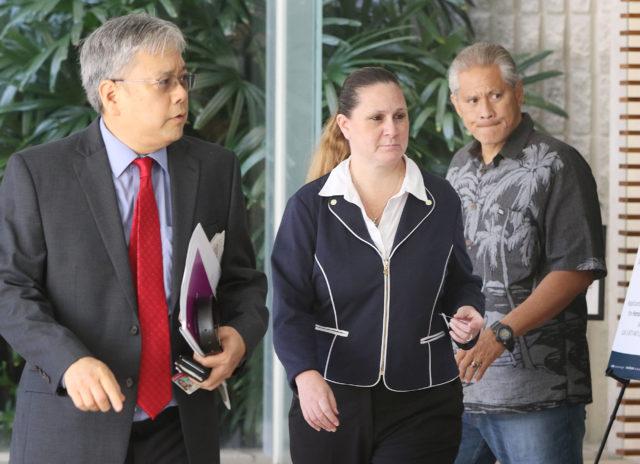 Ex HPD Chief Louis Kealoha wife Katherine Kealoha walk into District Court.