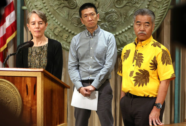 Governor David Ige with left, Dr Virginia Pressler and right, AG Doug Chin at press conference on escapee Saito who was apprehended in California.