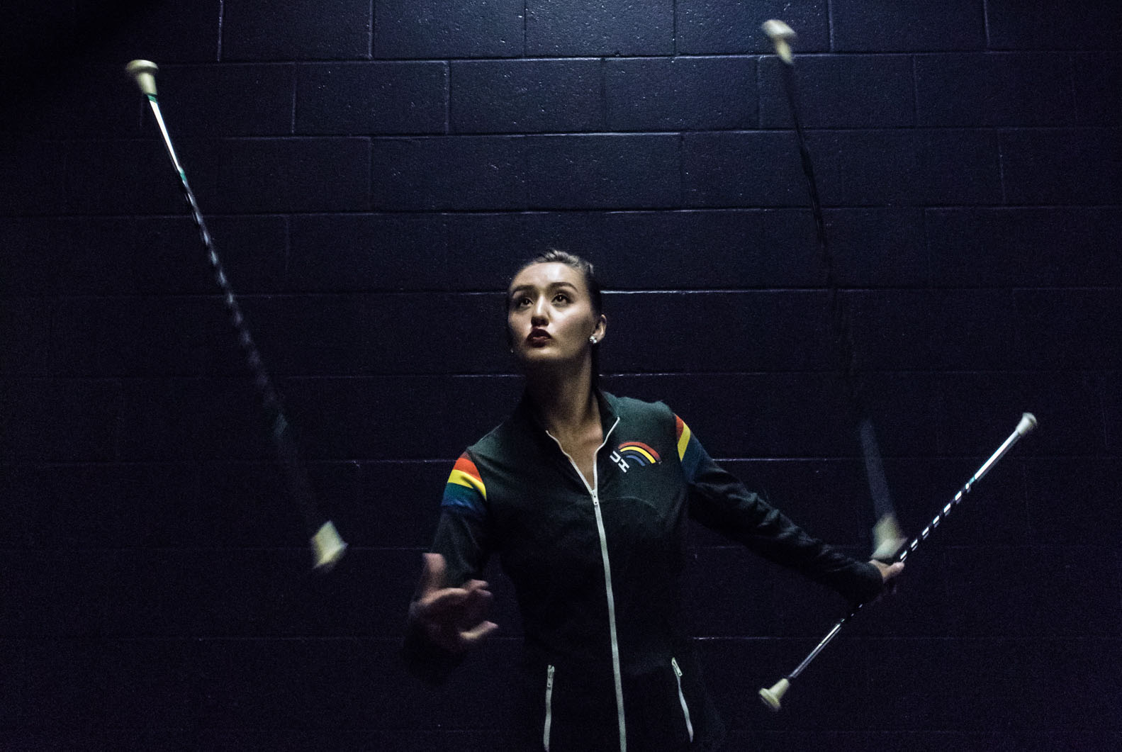 <p>Emily Dooms warms up for a night of baton twirling to entertain the crowd at a University of Hawaii volleyball game Oct. 7 at the Stan Sheriff Center. She&#8217;s been twirling for 18 years and has competed internationally for the United States Twirling Association.</p>
