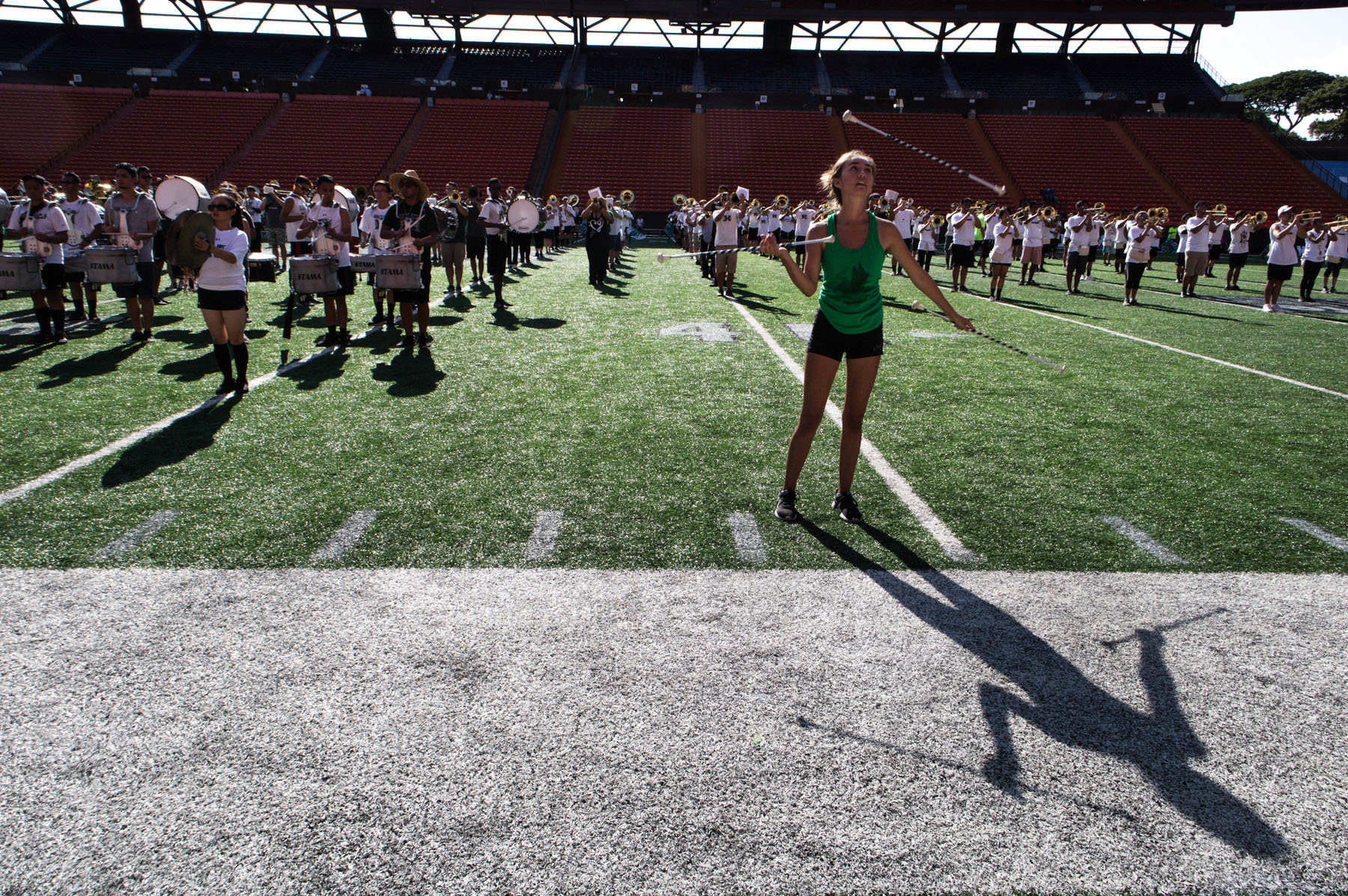<p>Dooms synchronizes her performance with the marching band during the gameday practice. &#8220;Everyone wants to see the twirler, not Emily.&#8221;</p>