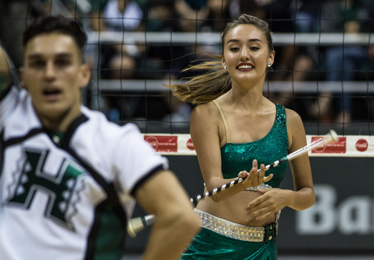 <p>On the court with UH cheerleaders, Dooms gets in some twirling during a lull in the action at the volleyball game. The biochemistry major says of being the school&#8217;s feature twirler: &#8220;It&#8217;s something that I love. It&#8217;s like an alternative side of me.&#8221;</p>