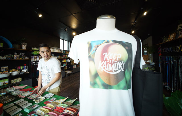 The Public Pet Founder and Creeative Director Jordan Lee at his shop with 'Keep it Kaimuki' shirt.