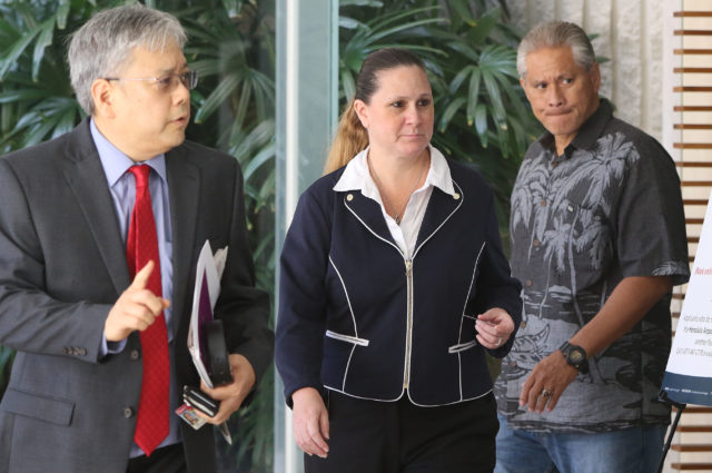 Katherine Kealoha and retired HPD Chief Louis Kealoha at the entrance of Federal District Court. Left, Attorney Kevin Sumida.
