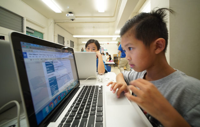 9-year-old AJ Matsuda works on his assignment in Momilani Elementary Tech lab class.