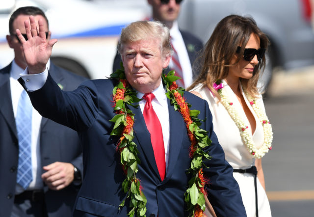 President Donald Trump and First Lady Melania Trump wave to crowd at Joint Base Hickam Pearl Harbor.