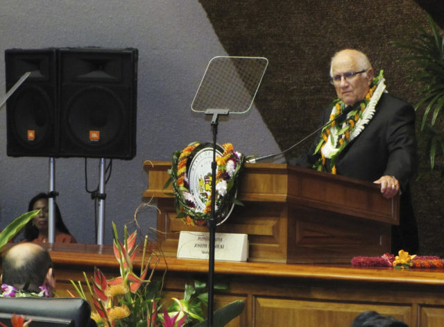 """File - In this Jan. 21, 2015, file photo, Hawaii House Speaker Joe Souki delivers opening remarks on the first day of the state's legislative session in Honolulu. Conflicts of interest are scattered around at the Hawaii State Legislature, where many lawmakers work outside jobs. Bills that could benefit or harm lawmakers' sources of income often come up. Lawmakers argue there are good reasons for voting even in such circumstances. """"The bottom line is that we are a part-time legislature,"""" Souki said. """"People work and they're going to have potential conflicts because of their job."""" (AP Photo/Cathy Bussewitz, File)"""