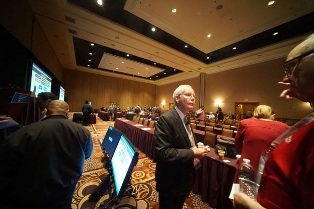 Dr Christopher Brigham as attendees speak to him after his talk entitled 'Living Abled ! Achieving Shorter Disability Durations and Better Outcomes at the National Workers Compensation Conference held at the Mandalay Bay Hotel.