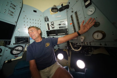 Terry Kerby, Chief Pilot for HURL inside the Pisces V submarine showing three windows at bottom right.