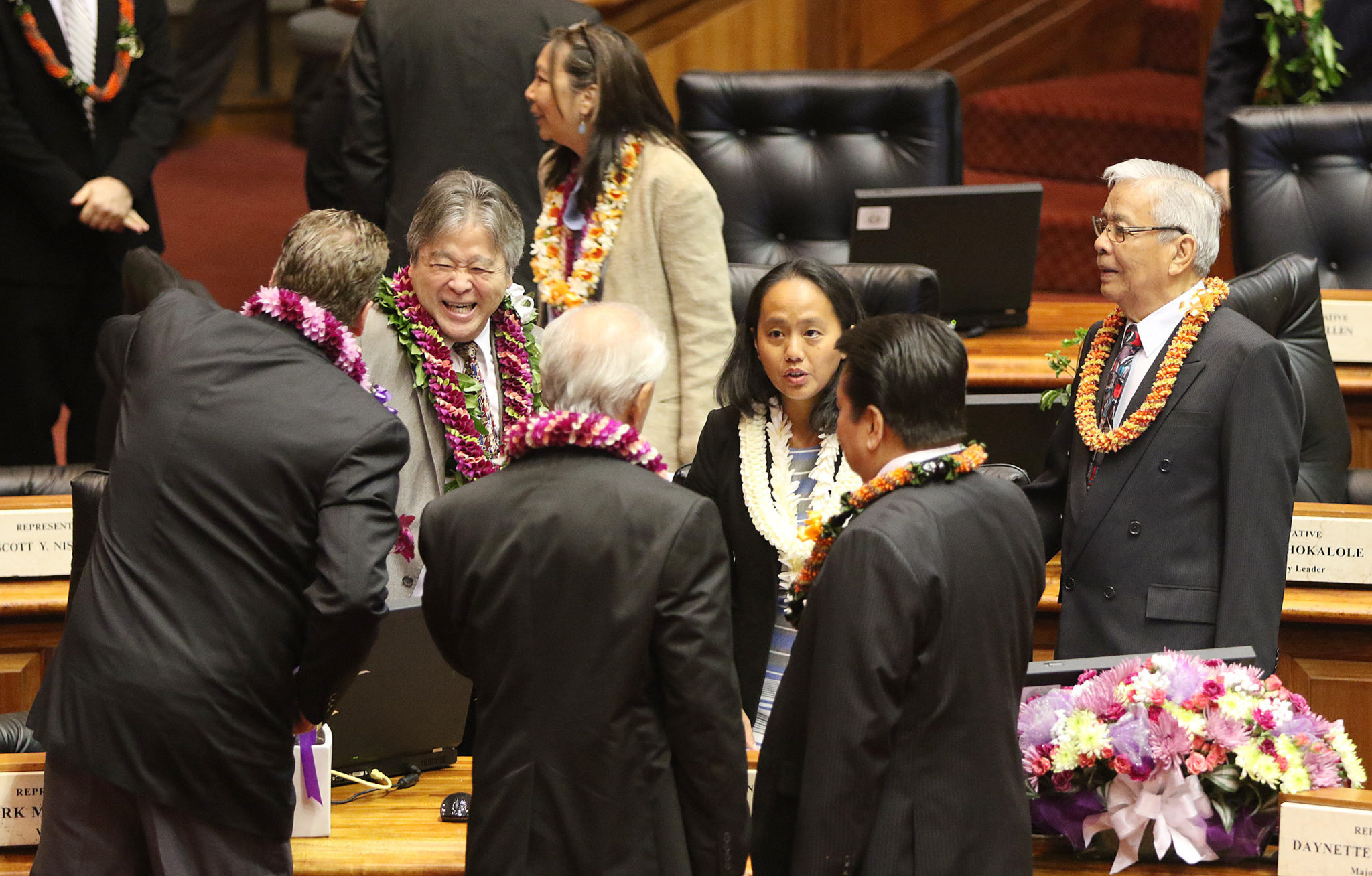 <p>New Majority leader Della Au Belatti, center, chatted with colleagues on the House floor during a recess.</p>