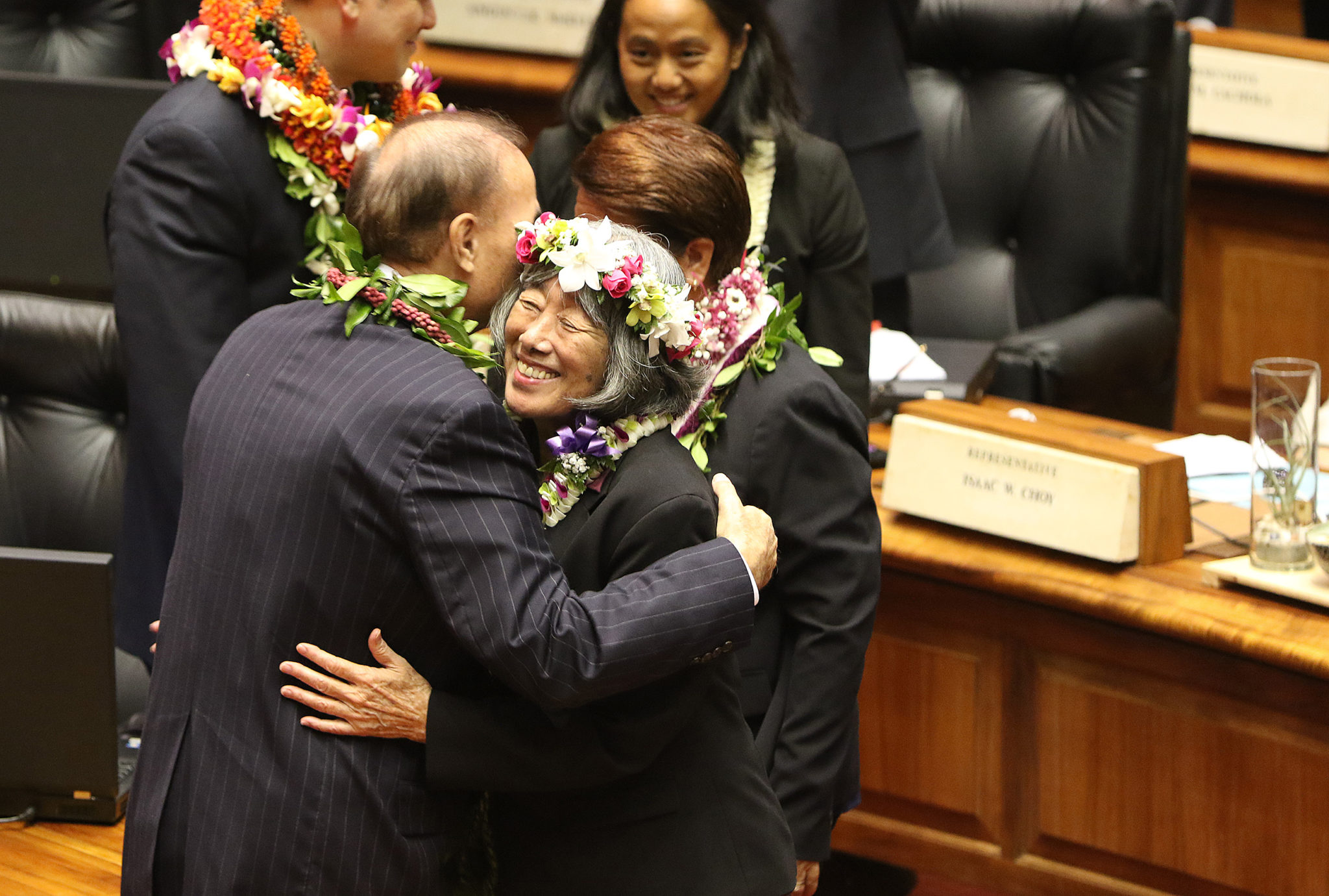 <p>Republican Rep. Gene Ward gave Rep. Lei Learmont a bipartisan welcome hug after she was sworn in.</p>