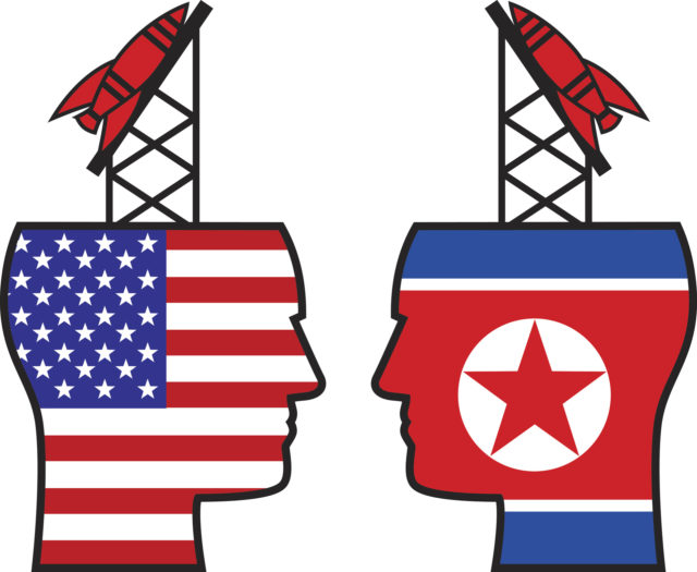 Vector illustration of face to face head with missle launchers on them. One has a flag of the USA and the other has a North Korea flag on it.
