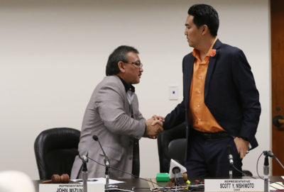 Death Dignity joint committee vote on measure, Representative/Chair John Mizuno shakes Rep Scott Nishimoto's after successfully moving measure to the senate.