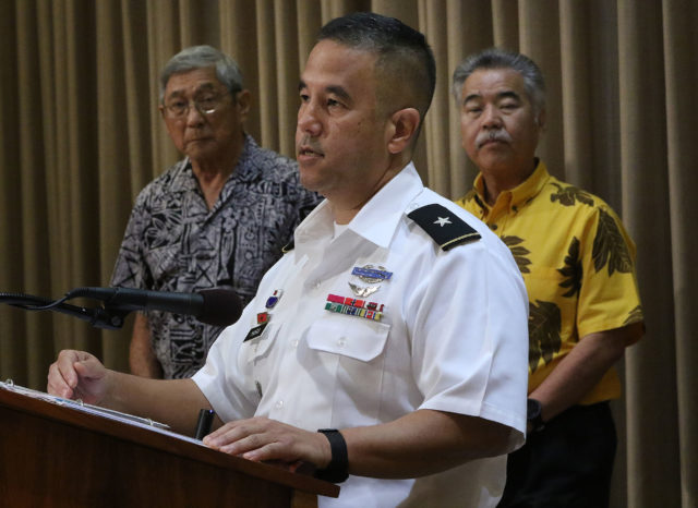HIEMA report presser Brigadier General Kenneth Hara speaks as Mayor Kim and Governor Ige look on.