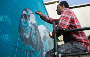 Watch This Artist Create A New Monk Seal Mural In Kakaako