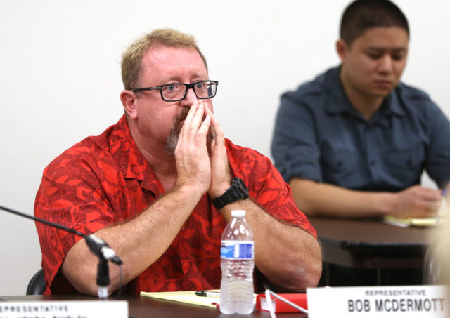 Rep Bob McDermott sits dumbfounded after remarking that he wanted a copy of the measure before voting on it, Chair Scott Nishimoto said he didn' t have time to get a copy to McDermott.