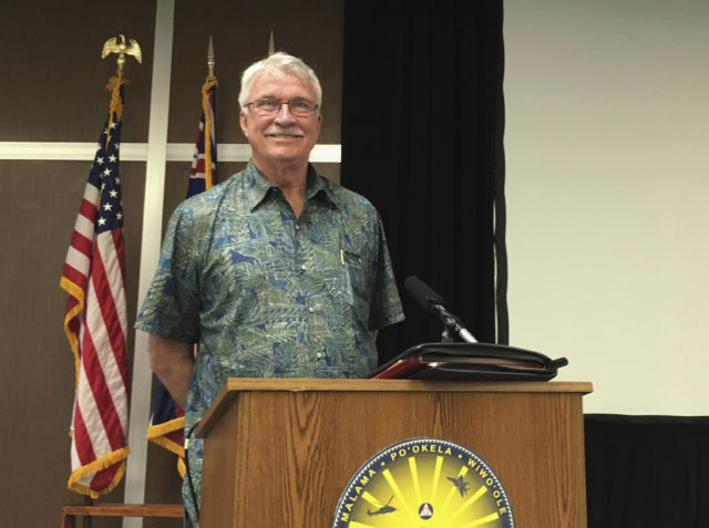 Thomas Travis poses for cameras at a news conference in Honolulu on Friday, March 16, 2018. Hawaii is appointing the retired Navy captain to lead an overhaul of the state Emergency Management Agency after an employee mistakenly sent an alert warning of a ballistic missile attack. (AP Photo/Audrey McAvoy)
