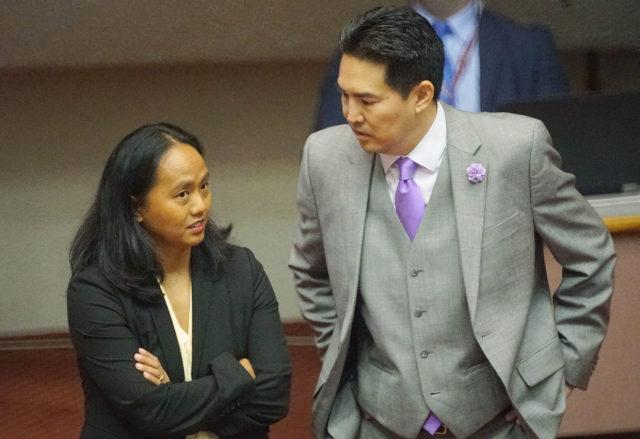 Rep Della Au Belatti and Rep Nishimoto talk before House floor session starts.