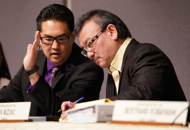 Rep Scott Nishimoto and Rep John Mizuno chat during death dying HB hearing in the Capitol Auditorium. 5 hour hearing.