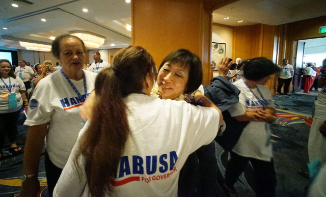 Congresswoman Colleen Hanabusa hugs supporters at inside the ballroom at the 2018 Democratic Convention held at the Hilton Waikaloa.