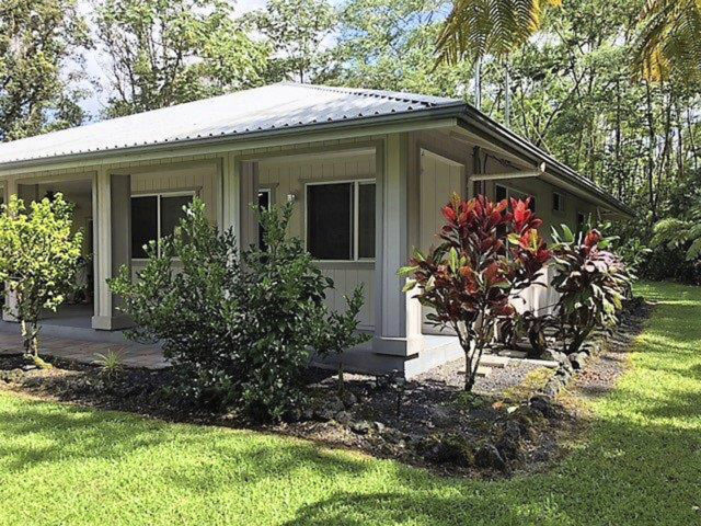 This October 2017 photo shows the home of Patricia Deter in Leilani Estates near the town of Pahoa on the island of Hawaii. Deter owned her Hawaii home for about a month before lava from a volcano eruption burned it down. Now her daughters are scrambling to sort out what the 88-year-old's homeowner insurance will cover. Officials say multiple homes have been destroyed after lava from Kilauea volcano oozed out of cracks in the Leilani Estates subdivision. Few insurance companies will write policies for that area. (Heather E. Hedenschau/Big Island Brokers via AP)