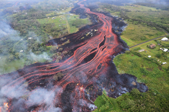U.S. Geological Survey lava flows from fissures near Pahoa Hawaii. Kilauea volcano began erupting more than two weeks ago and has burned dozens of homes forced people to flee and shot up plumes of