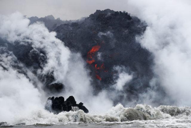 FILE - In this May 20, 2018 file photo, lava flows into the ocean near Pahoa, Hawaii. (AP Photo/Jae C. Hong, File)