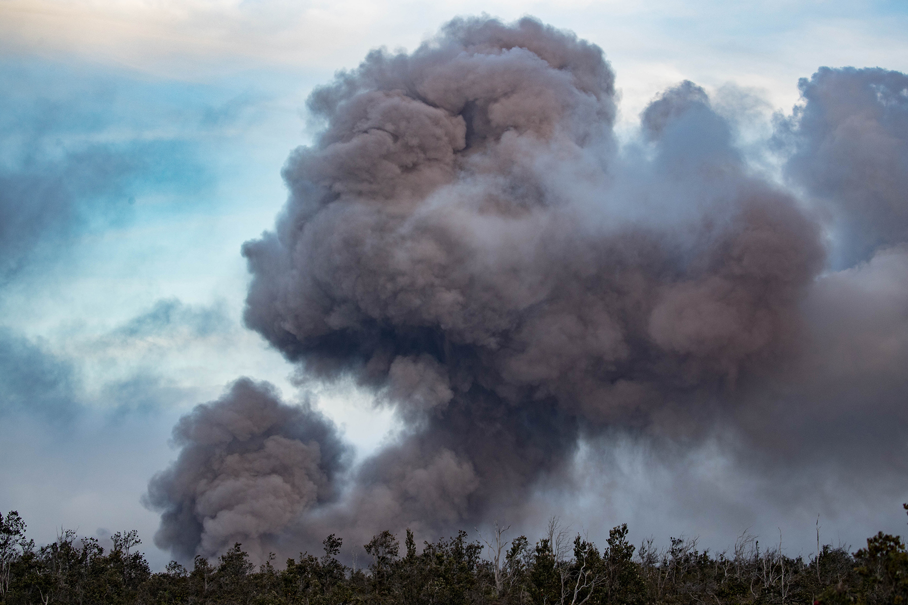 <p>Halemaumau crater shooting clouds of ash into the sky Friday evening as seen from Mamalohoa Highway.</p>