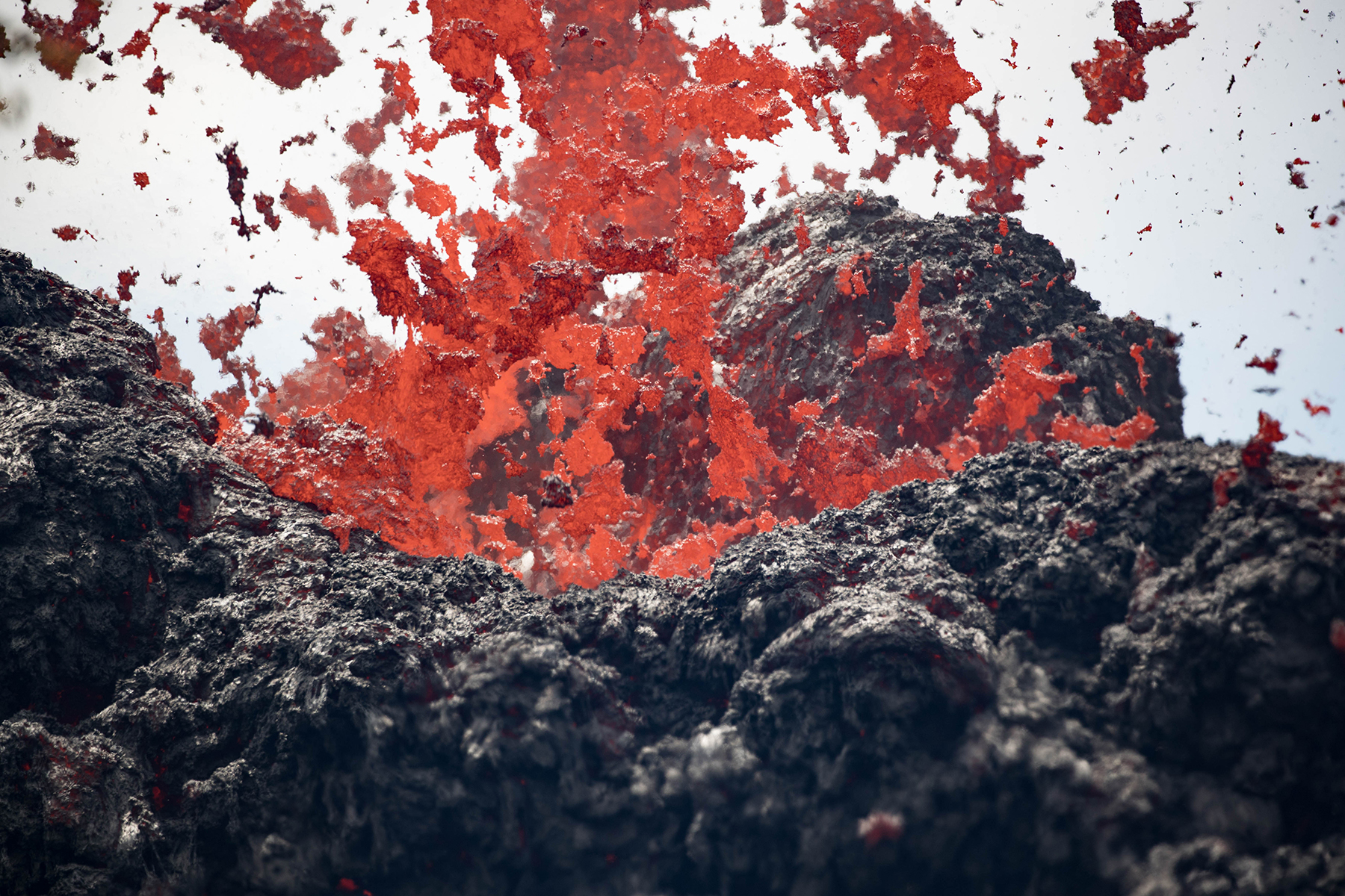<p>Lava shoots into the air Saturday from a newly opened fissure in Lower Puna. The U.S. Geological Survey said 18 fissures, emitting lava and steam, have opened up on the Big island.</p>