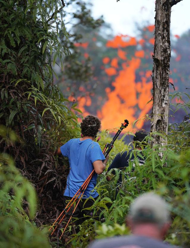 Other photographers walk into areas close to the Leilani Estate erupting lava. Pahoa, Hawaii.