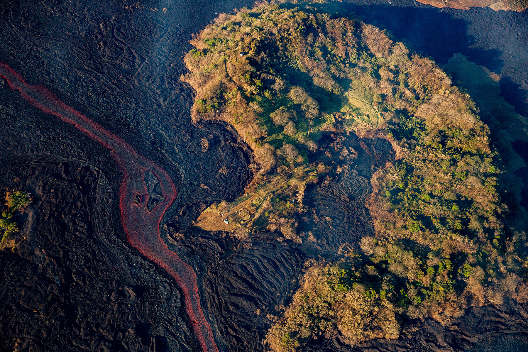 <p>Before Kapoho crater was surrounded by lava, a flow entered the center, consuming what was known as Green Lake.</p>