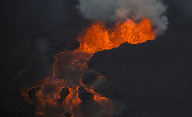 The Kilauea Volcano east rift zone eruption continues mainly from a fissure and forms a river of lava flowing down to Kapoho on Sunday, June 10, 2018, in Pahoa, Hawaii. (AP Photo/L.E. Baskow)