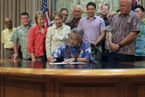 Ige Signs Law Banning Widely Used Pesticide