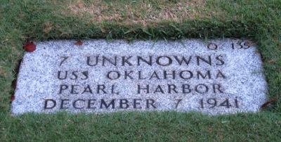 This Dec. 5, 2012 photo at the National Memorial Cemetery of the Pacific in Honolulu shows a gravestone identifying it as the resting place of 7 unknown people from the USS Oklahoma who died in Japanese bombing of Pearl Harbor. A survivor of the attack on Pearl Harbor is saying his final goodbyes to the site where thousands of fellow servicemen died in the Japanese bombing 77 years ago. Ray Emory, 97, is making what could be his last visit to the pier where his ship sat on Dec. 7, 1941, before he moves to the U.S. mainland to be near family. (AP Photo/Audrey McAvoy)