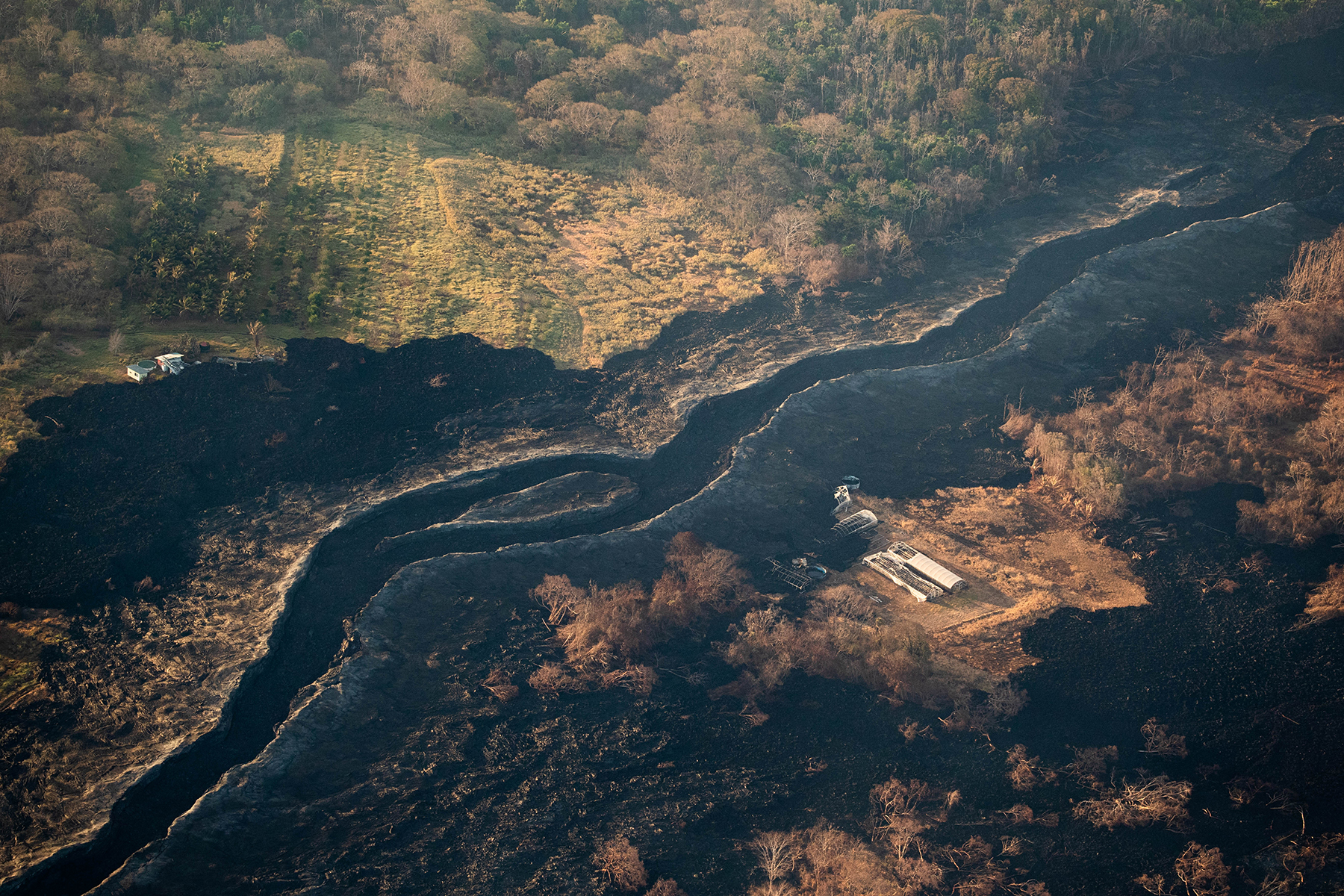 <p>Land scarred by an earlier lava flow during the eruption that began May 3.</p>