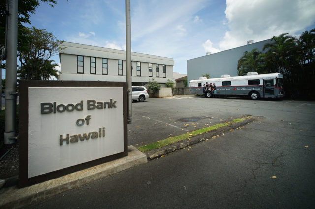 Blood Bank of Hawaii Dillingham Headquarters with mobile bus at right.