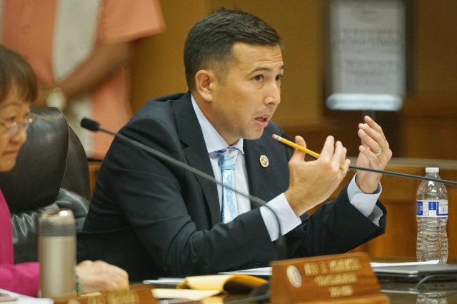 Budget Chair Council member Trevor Ozawa makes point Bill 35 about putting a cap on ride share services in Honolulu.