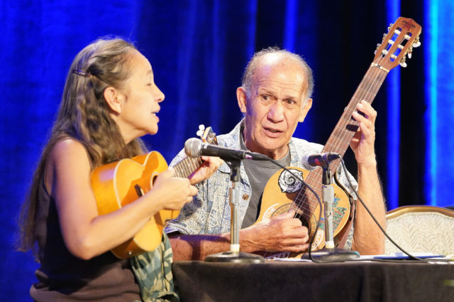 Right, Liko Martin sings with Laulani Teale Democratic party convention held at the Waikaloa Resort. Kona, Hawaii.