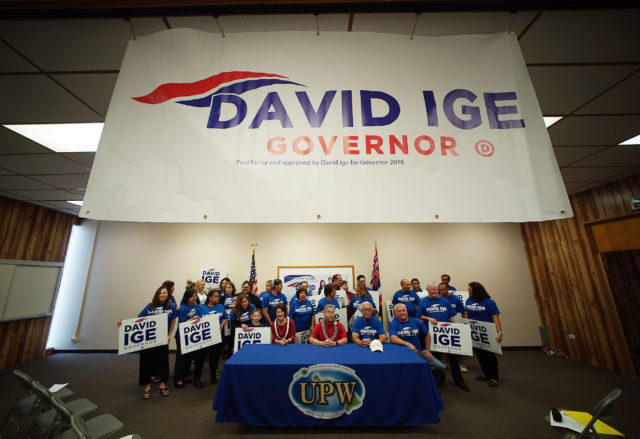 UPW endorses Governor David Ige 2018 campaign as supporters from UPW make photographs with their phones.