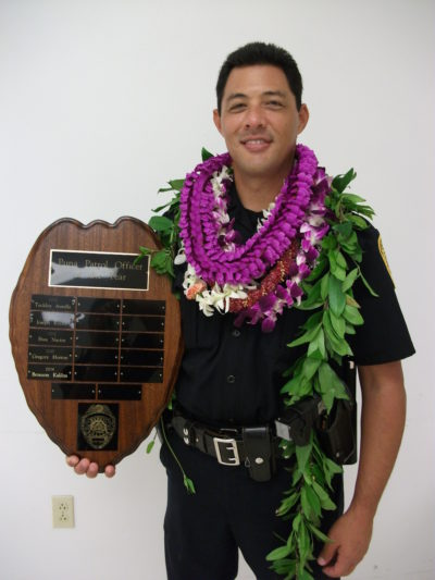 This undated photo provided by the Hawaii County Police Department shows Officer Bronson Kaliloa. A manhunt is underway for a suspect wanted for fatally shooting Kaliloa during a traffic stop on Hawaii's Big Island, officials said Wednesday, July 18, 2018. (Hawaii County Police Department via AP)