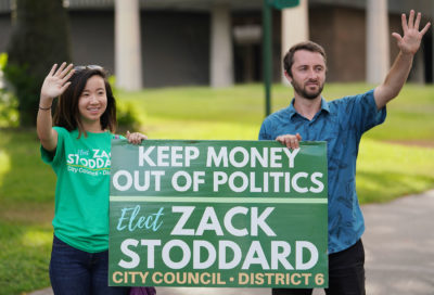 Zachary Stoddard CIty Council candidate 2018 elections stands and waves with campaign manager Connie Choy at Punchbowl and Beretania Street.