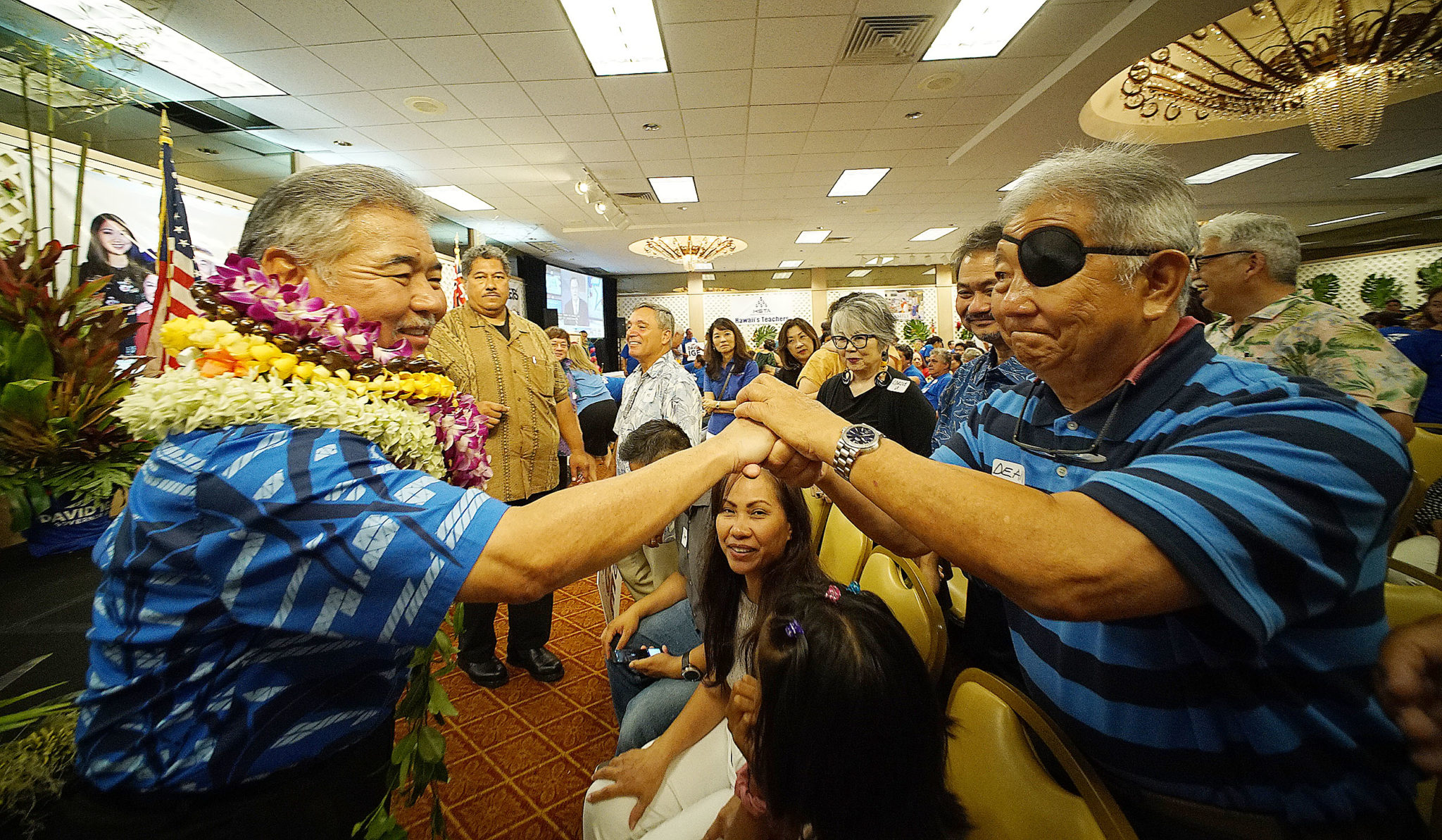 <p>Gov. David Ige, left, greets supporters at the Pagoda Hotel after the second round of results are released, showing him maintaining his lead.</p>