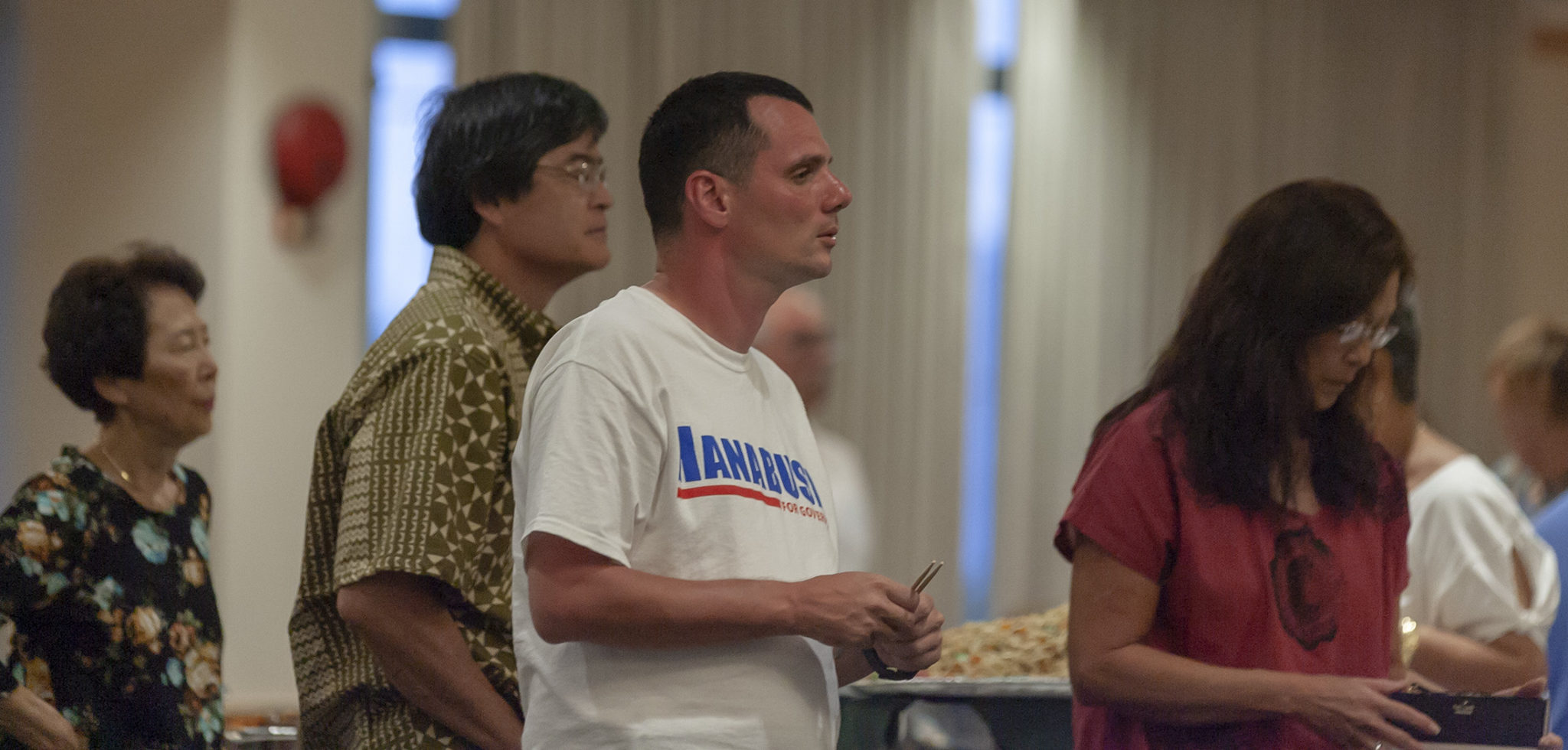 <p>Joseph Mangi, center, of Waikiki, is among the supporters of Congresswoman Colleen Hanabusa who aren&#8217;t enthused by the early results showing her trailing Gov. David Ige.</p>