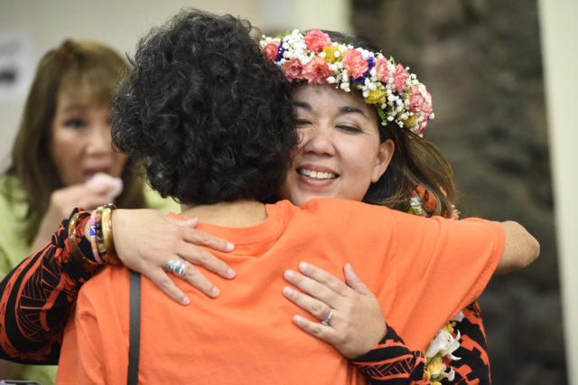 Jill Tokuda getting hug from supporters at headquarters Saturday night, August 11, 2018. (Civilbeat photo by Ronen Zilberman)