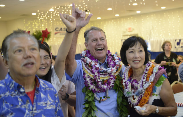 Ed Case and wife Audrey Nakamura smils at headquarters Saturday night, August 11, 2018. (Civilbeat photo by Ronen Zilberman)
